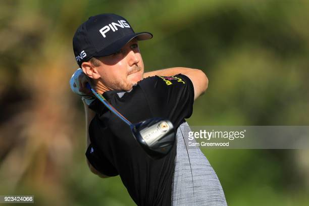 Mackenzie Hughes of Canada plays his tee shot on the eighth hole during the second round of the Honda Classic at PGA National Resort and Spa on...