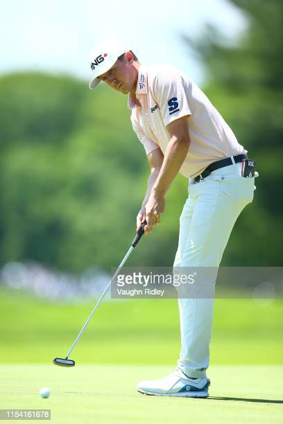 Mackenzie Hughes of Canada putts on the fourth green during the first round of the RBC Canadian Open at Hamilton Golf and Country Club on June 06...