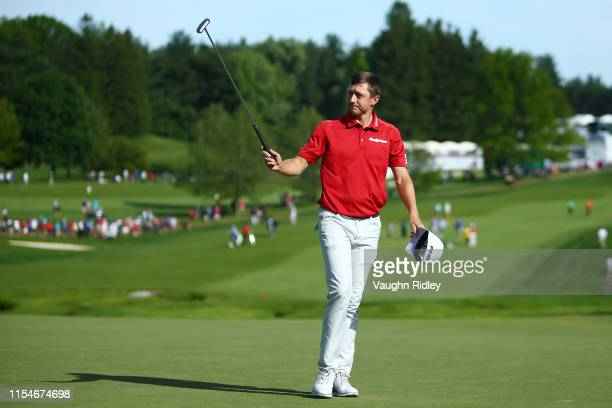 Mackenzie Hughes of Canada reacts after a putt on the 18th green during the third round of the RBC Canadian Open at Hamilton Golf and Country Club on...