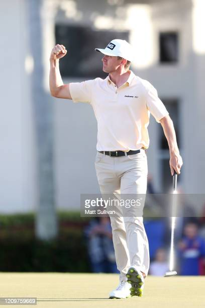 MacKenzie Hughes of Canada reacts after making a birdie putt on the 17th hole during the Honda Classic at PGA National Resort and Spa Champion course...