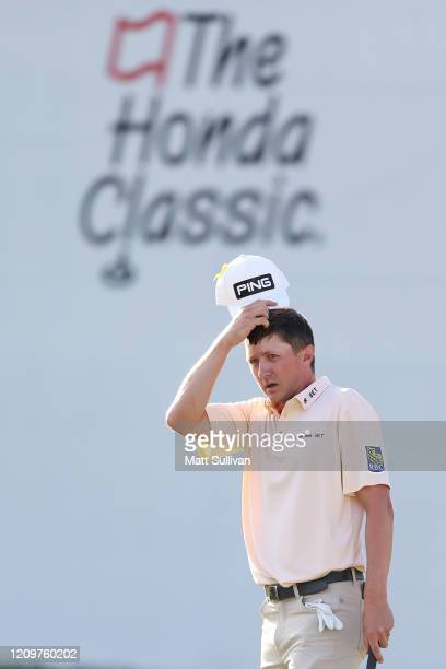 MacKenzie Hughes of Canada reacts after missing a putt on the 16th hole during the Honda Classic at PGA National Resort and Spa Champion course on...