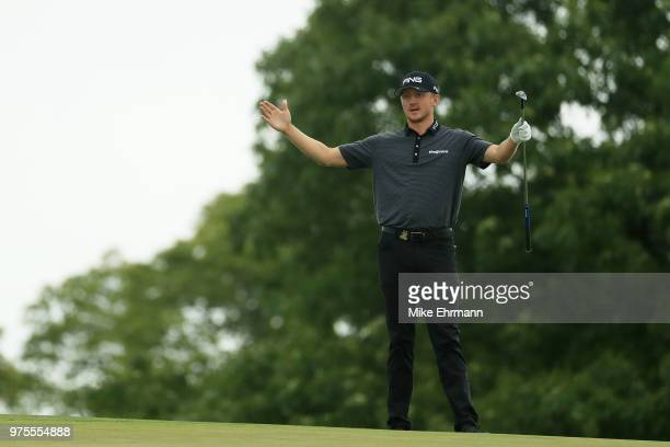 Mackenzie Hughes of Canada reacts to a shot by Aaron Baddeley of Australia on the tenth hole during the second round of the 2018 US Open at...