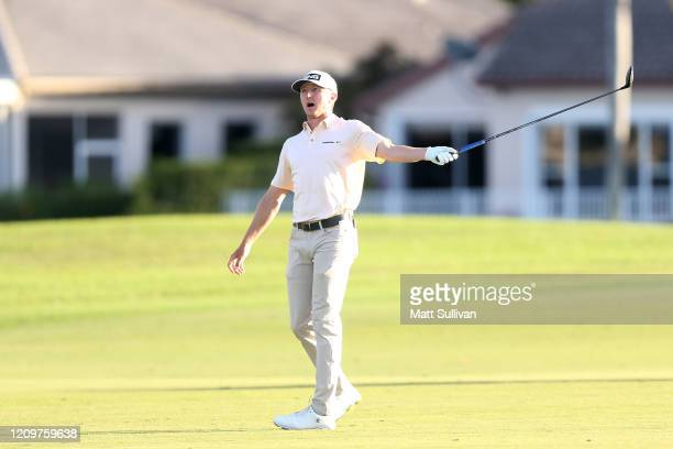 MacKenzie Hughes of Canada reacts to his second shot on the 18th hole during the Honda Classic at PGA National Resort and Spa Champion course on...