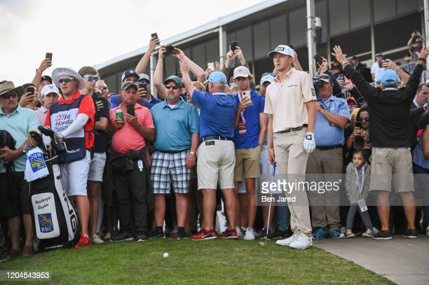 Mackenzie Hughes of Canada stands behind his ball on the 18th hole during the final round of The Honda Classic at PGA National Champion course on...