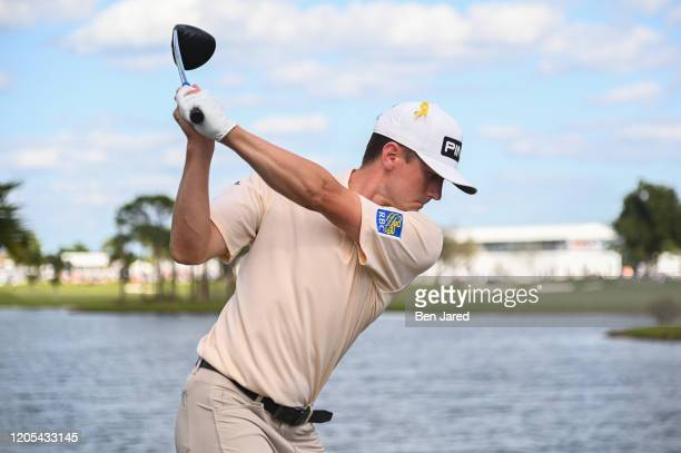 Mackenzie Hughes of Canada swings over his ball on the ninth tee during the final round of The Honda Classic at PGA National Champion course on March...