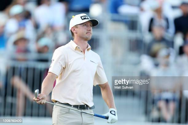 MacKenzie Hughes of Canada watches his tee shot on the 17th hole during the Honda Classic at PGA National Resort and Spa Champion course on March 01...