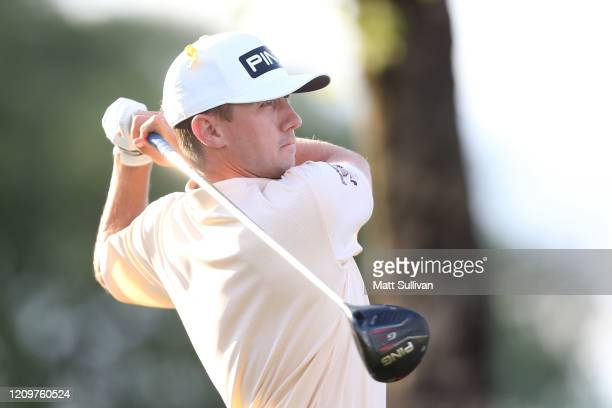 MacKenzie Hughes of Canada watches his tee shot on the 18th hole during the final round of the Honda Classic at PGA National Resort and Spa Champion...