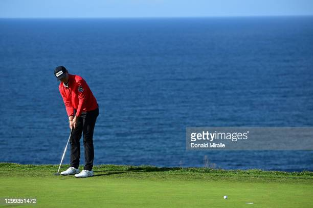 Mackenzie Hughes putts on the 4th hole green during round two of the Farmers Insurance Open at Torrey Pines on January 29, 2021 in San Diego,...