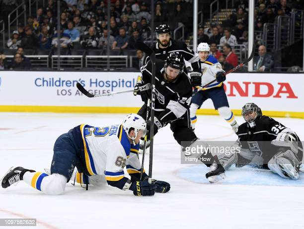 Mackenzie MacEachern of the St Louis Blues scores a goal past Jonathan Quick of the Los Angeles Kings and Derek Forbort for a 10 lead during the...