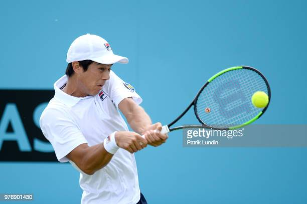 Mackenzie McDonald of the United States hits a backhand during the qualifying match against Julien Benneteau of France during qualifying Day 2 of the...