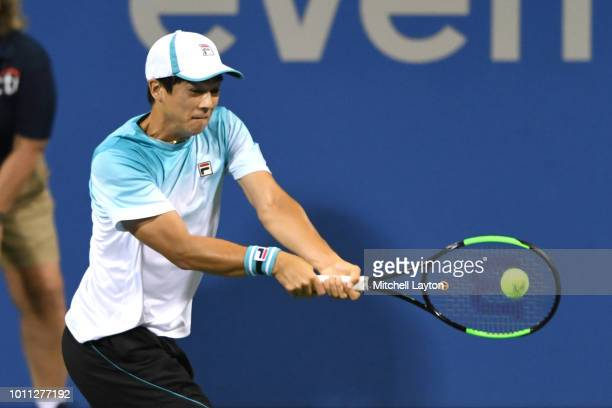 Mackenzie McDonald of the United States hits a backhand shot to Andy Murray of Great Britain during day three of the Citi Open at the Rock Creek...