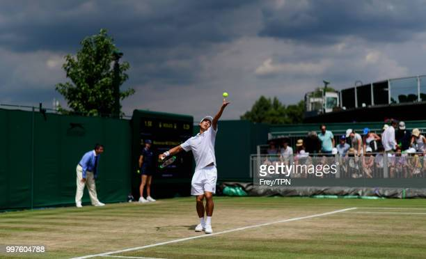 Mackenzie McDonald of the United States in action against Milos Raonic of Canada in the fourth round of the gentlemen's singles at the All England...