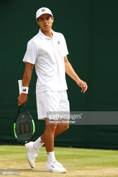 Mackenzie McDonald of the United States looks on against Milos Raonic of Canada during their Men's Singles fourth round match on day seven of the...