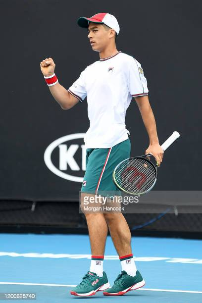 Mackenzie McDonald of the United States of America celebrates after winning a point during his Men's Singles first round match against Daniel Evans...