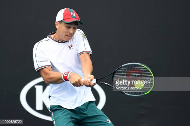 Mackenzie McDonald of the United States of America plays a backhand during his Men's Singles first round match against Daniel Evans of Great Britain...