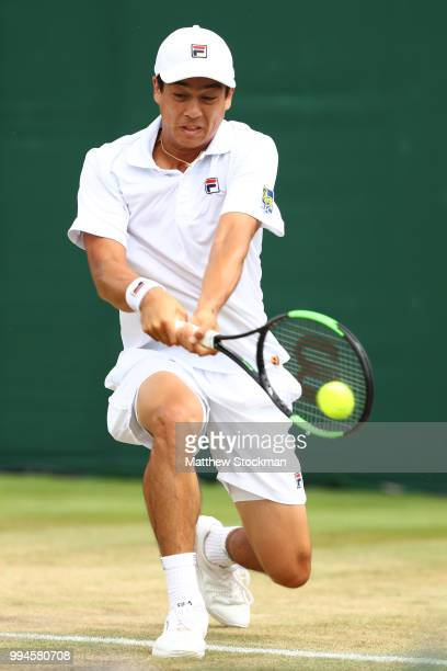 Mackenzie McDonald of the United States plays a backhand against Milos Raonic of Canada during their Men's Singles fourth round match on day seven of...