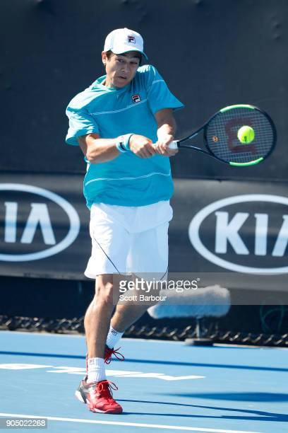 Mackenzie McDonald of the United States plays a backhand in his first round match against Elias Ymer of Sweden on day one of the 2018 Australian Open...