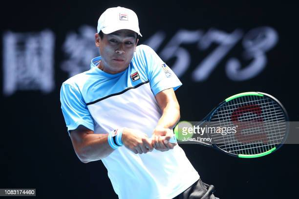 Mackenzie Mcdonald of the United States plays a backhand in his second round match against Marin Cilic of Croatia during day three of the 2019...