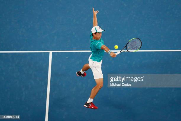 Mackenzie McDonald of the United States plays a backhand in his second round match against Grigor Dimitrov of Bulgaria on day three of the 2018...