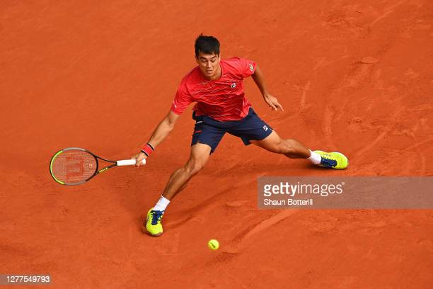 Mackenzie McDonald of the United States plays a forehand during his Men's Singles second round match against Rafael Nadal of Spain on day four of the...
