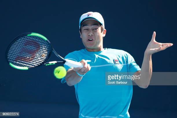 Mackenzie McDonald of the United States plays a forehand in his first round match against Elias Ymer of Sweden on day one of the 2018 Australian Open...
