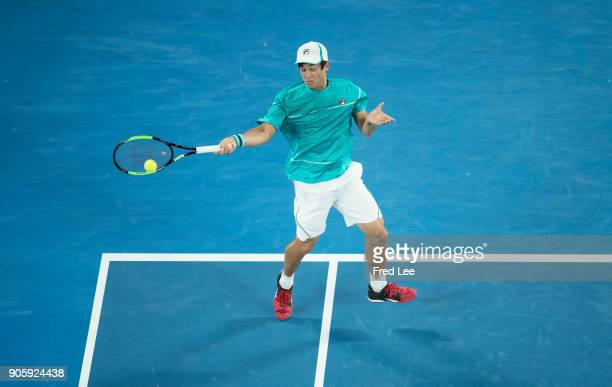 Mackenzie McDonald of the United States plays a forehand in his second round match against Grigor Dimitrov of Bulgaria on day three of the 2018...