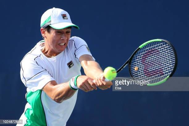 Mackenzie McDonald of The United States returns the ball during his men's singles first round match against Robin Haase of The Netherlands on Day Two...