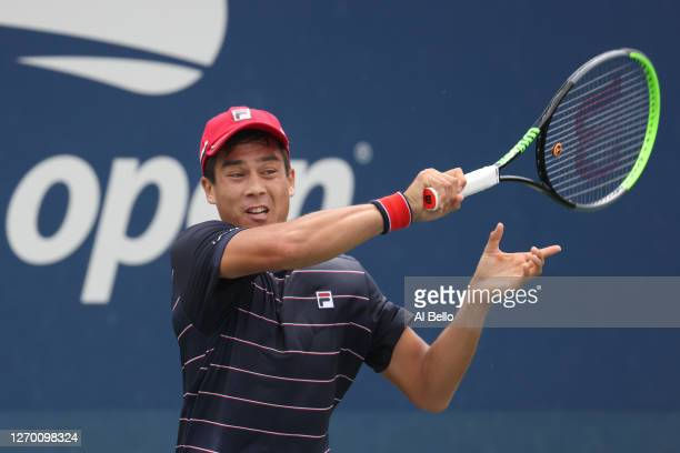 Mackenzie McDonald of the United States returns the ball during his Men's Singles first round match against Casper Ruud of Norway on Day Two of the...
