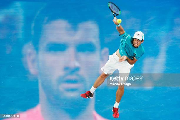 Mackenzie McDonald of the United States serves against Grigor Dimitrov of Bulgaria on day three of the 2018 Australian Open at Melbourne Park on...