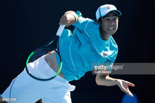 Mackenzie McDonald of the United States serves in his first round match against Elias Ymer of Sweden on day one of the 2018 Australian Open at...