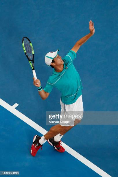 Mackenzie McDonald of the United States serves in his second round match against Grigor Dimitrov of Bulgaria on day three of the 2018 Australian Open...