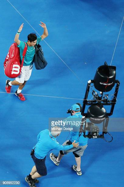Mackenzie McDonald of the United States thanks the crowd after losing in his second round match against Grigor Dimitrov of Bulgaria on day three of...