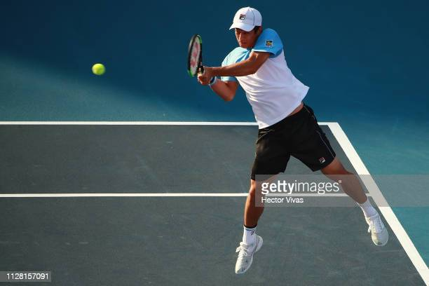 Mackenzie McDonald of United States returns a ball during the quarterfinals match between Mackenzie McDonald of United States and Cameron Norrie of...