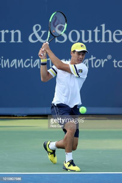Mackenzie McDonald returns a shot to Kyle Edmund of Great Britain during Day 2 of the Western and Southern Open at the Lindner Family Tennis Center...