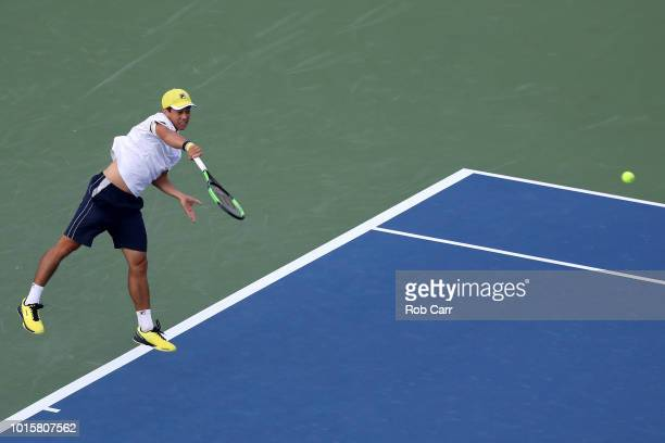 Mackenzie McDonald serves to Kyle Edmund of Great Britain during Day 2 of the Western and Southern Open at the Lindner Family Tennis Center on August...