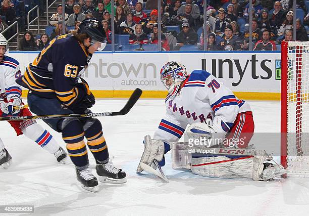 Mackenzie Skapski of the New York Rangers makes a save while Tyler Ennis of the Buffalo Sabres looks for a rebound on February 20 2015 at the First...