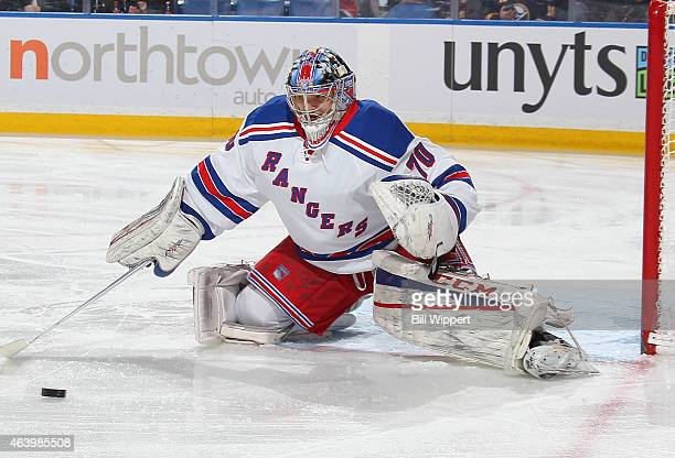 Mackenzie Skapski of the New York Rangers playing in his first NHL game makes a first period save against the Buffalo Sabres on February 20 2015 at...