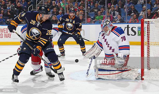 Mackenzie Skapski of the New York Rangers playing in his first NHL game makes a save against Zemgus Girgensons of the Buffalo Sabres on February 20...