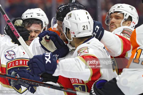 MacKenzie Weegar of the Florida Panthers is grabbed in the face as Florida Panthers and Philadelphia Flyers push and shove during the second period...