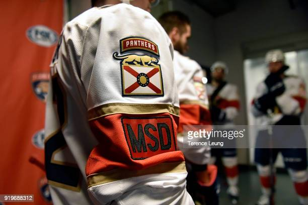 MacKenzie Weegar of the Florida Panthers sports a Marjory Stoneman Douglas High School badge on his jersey as he waits for warmups before NHL game...