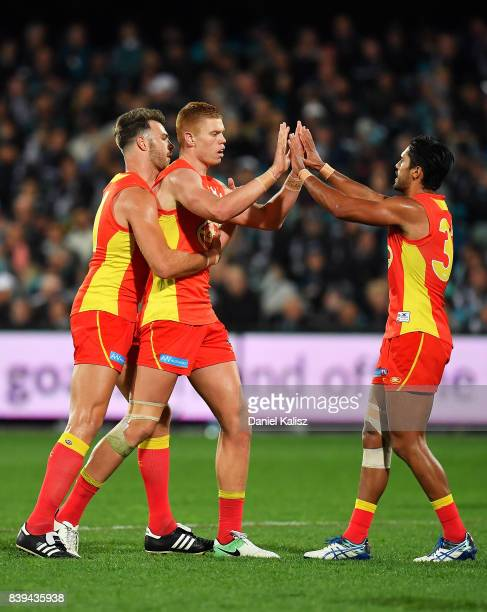 Mackenzie Willis of the Suns celebrates after kicking a goal during the round 23 AFL match between the Port Adelaide Power and the Gold Coast Suns at...