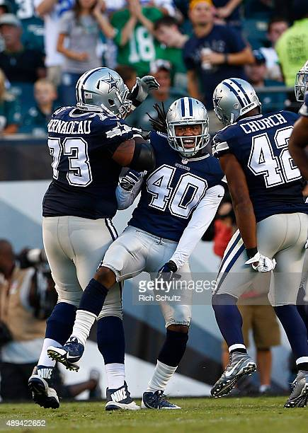 Mackenzy Bernadeau and Barry Church celebrate with Danny McCray of the Dallas Cowboys who blocked a punt that was returned for a touchdown by Kyle...
