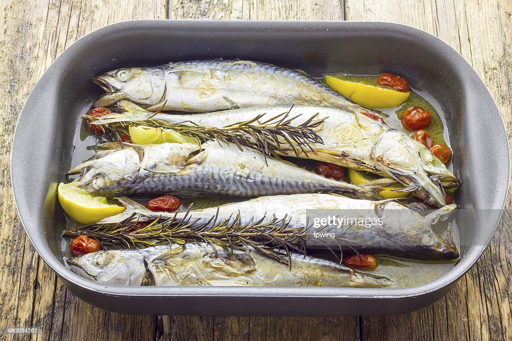 Mackerel baked with tomatoes : Stock Photo