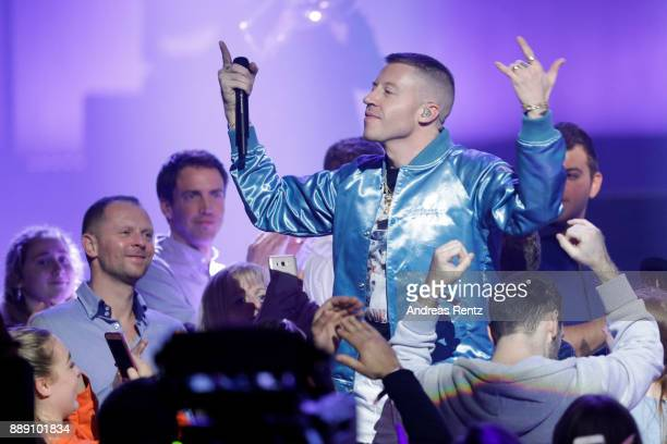 Macklemore aka Benjamin Hammond Haggerty performs during the 1Live Krone radio award at Jahrhunderthalle on December 07 2017 in Bochum Germany