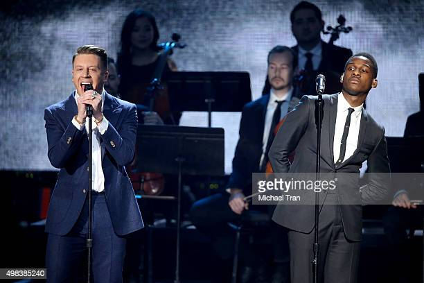Macklemore and Leon Bridges perform onstage at the 2015 American Music Awards at Microsoft Theater on November 22 2015 in Los Angeles California