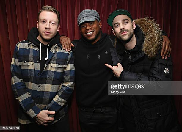 Macklemore and Ryan Lewis pose with SiriusXM host Sway Calloway during a visit to the SiriusXM Studios on January 25 2016 in New York City