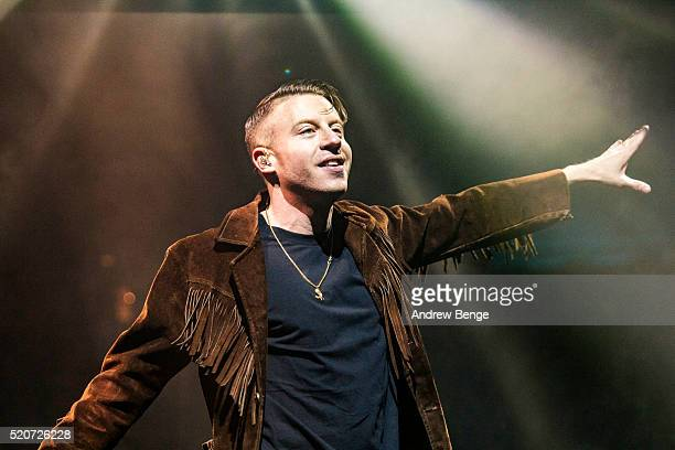 Macklemore of Macklemore Ryan Lewis performs on stage at Manchester Arena on April 12 2016 in Manchester England