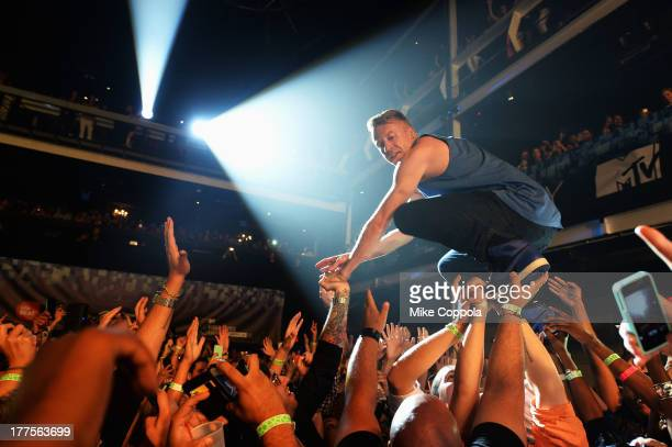 Macklemore performs at the 2013 MTV VMAs Concert to Benefit LifeBeat presented by MTV and Time Warner Cable at Terminal 5 on August 23 2013 in New...