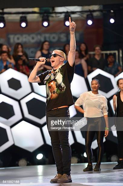Macklemore performs at the 2016 iHeartRADIO MuchMusic Video Awards at MuchMusic HQ on June 19 2016 in Toronto Canada