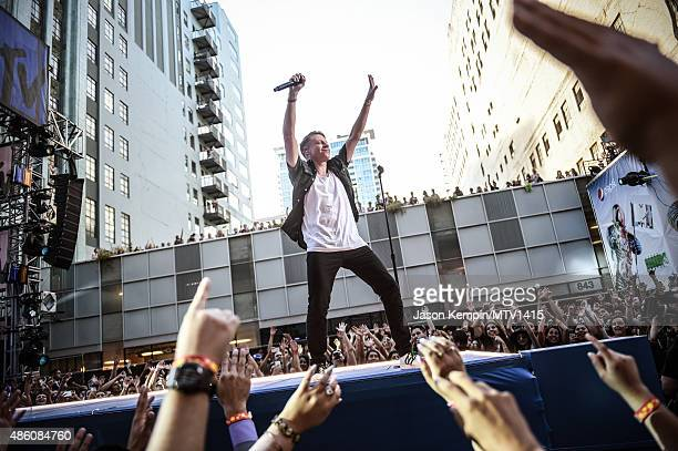 Macklemore performs at The Orpheum Theatre on August 30 2015 in Los Angeles California